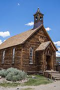 "Methodist Church at Bodie, California's official state gold rush ghost town. Bodie State Historic Park lies in the Bodie Hills east of the Sierra Nevada mountain range in Mono County, near Bridgeport, California, USA. After W. S. Bodey's original gold discovery in 1859, profitable gold ore discoveries in 1876 and 1878 transformed ""Bodie"" from an isolated mining camp to a Wild West boomtown. By 1879, Bodie had a population of 5000-7000 people with 2000 buildings. At its peak, 65 saloons lined Main Street, which was a mile long. Bodie declined rapidly 1912-1917 and the last mine closed in 1942. Bodie became a National Historic Landmark in 1961 and Bodie State Historic Park in 1962."