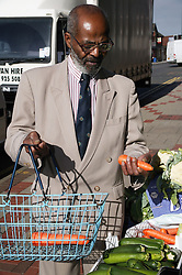 Man shopping at green grocers,