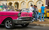 Havana, Cuba - Taxis wait for fares in front of Hotel Parque Central. Classic American cars from the 1950s, imported before the U.S. embargo, are commonly used as taxis in Havana.