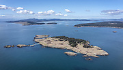 Spring brings new life to the Salish Sea, with Long Island in the foreground, San Juan island in the distance at left and Lopez Island right. (Steve Ringman / The Seattle Times)