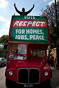 The Respect Party bus. Predominantly Muslim voters, and supporters outside a Polling Station in Whitechapel, in the East End of London. General Election Day May 6th 2010.