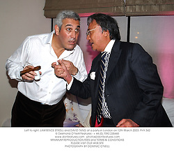 Left to right, LAWRENCE STROLL and DAVID TANG at a party in London on 12th March 2003.	PHY 342