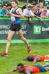 Beach to Beacon 10K: Ben True, USA, finishes 3rd, passing Karoki and Kibet laying on grass ofter finishing 1-2