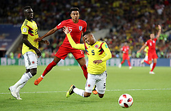 England's Jesse Lingard (centre) and Colombia's Wilmar Barrios battle for the ball during the FIFA World Cup 2018, round of 16 match at the Spartak Stadium, Moscow.