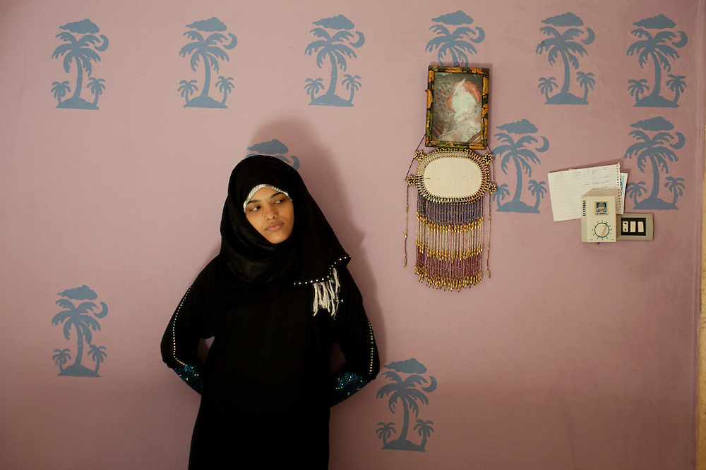 Shaimaa stands in her room in Cairo, Egypt.