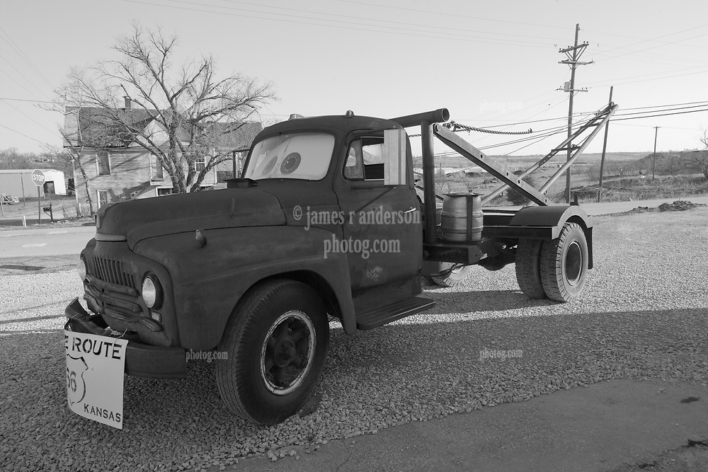 "The Tow Truck that inspired the Cars Film Character Mater. At the corner ""Four Women on the Route"" Front and S. Main Streets, Galena, KS on old Route 66. Side View with Beer Keg. B&W Conversion"