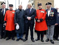 © Licensed to London News Pictures. 02/05/2012. London, UK London Mayor,Boris Johnson(centre, Black Suit) is joined bycomedian Al Murrayto wave off an army ofWWII veterans who are embarking on an iconic trip to the Netherlands, via a convoy of black cabs.The London Taxi Benevolent Association for the War Disabled has organised a trip for 160 WWII veterans to travel to Holland in 80 London Black Cabs. The veterans, mostly aged between 85 and 94, will start their journey from London today 2nd May 2012 and will be visiting sites of importance from WWII and taking part in Dutch Liberation Day celebrations as guests of honour of the Dutch Royal Family.. Photo credit : Stephen Simpson/LNP