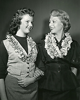 1952 Dinah Shore, Chairman of the Hollywood YWCA Orchid sale, with a member of the YWCA