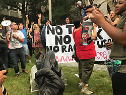 August 14, 2017 - Durham, NC, USA - Protesters celebrate after toppling a Confederate statue in downtown Durham, N.C. Monday afternoon, Aug. 14, 2017. (Credit Image: © Casey Toth/TNS via ZUMA Wire)