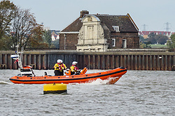 © Licensed to London News Pictures. 11/10/2018. London, UK. An RNLI crew keep a watch for Benny the beluga whale in the River Thames between Gravesend and Tilbury. The whale is still stuck in the same spot on the river east of London after two weeks. Photo credit: Graham Long/LNP