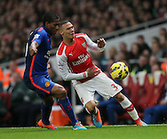 Arsenal's Kieran Gibbs tussles with Manchester United's Antonio Valencia<br /> <br /> Barclays Premier League- Arsenal vs Manchester United - Emirates Stadium - England - 22nd November 2014 - Picture David Klein/Sportimage