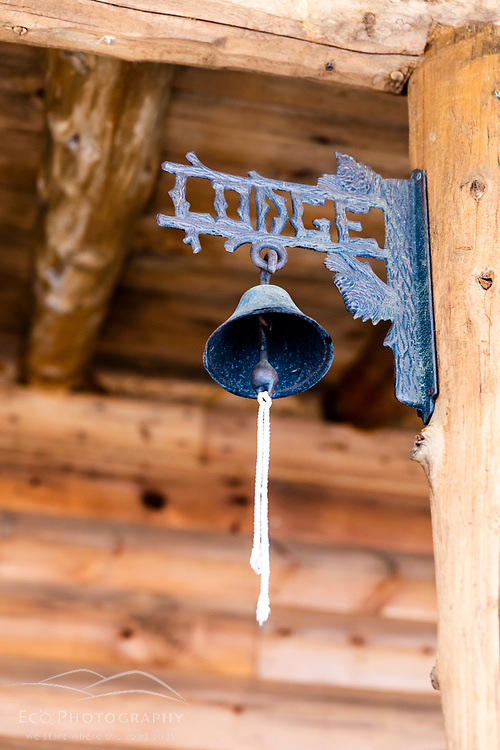 A bell outside the main lodge at Matagamon Wilderness Camps just outside Maine's Katahdin Woods and Waters National Monument.