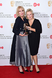 Jennifer Saunders (right) presents Joanna Lumley with the Fellow Award in the press room at the Virgin TV British Academy Television Awards 2017 held at Festival Hall at Southbank Centre, London. PRESS ASSOCIATION Photo. Picture date: Sunday May 14, 2017. See PA story SHOWBIZ Bafta. Photo credit should read: Ian West/PA Wire