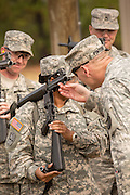 A woman Drill Sergeant candidate has her weapon inspected at the US Army Drill Instructors School Fort Jackson during weapons training September 26, 2013 in Columbia, SC. While 14 percent of the Army is women soldiers there is a shortage of female Drill Sergeants.