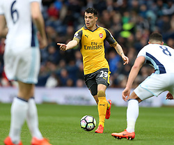 18 March 2017 Premier League Football : West Bromwich Albion v Arsenal :<br /> Granit Xhaka of Arsenal looking for a colleague in space.<br /> Photo: Mark Leech