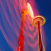 Seattle Space Needle and a carnival ride at the Seattle Center