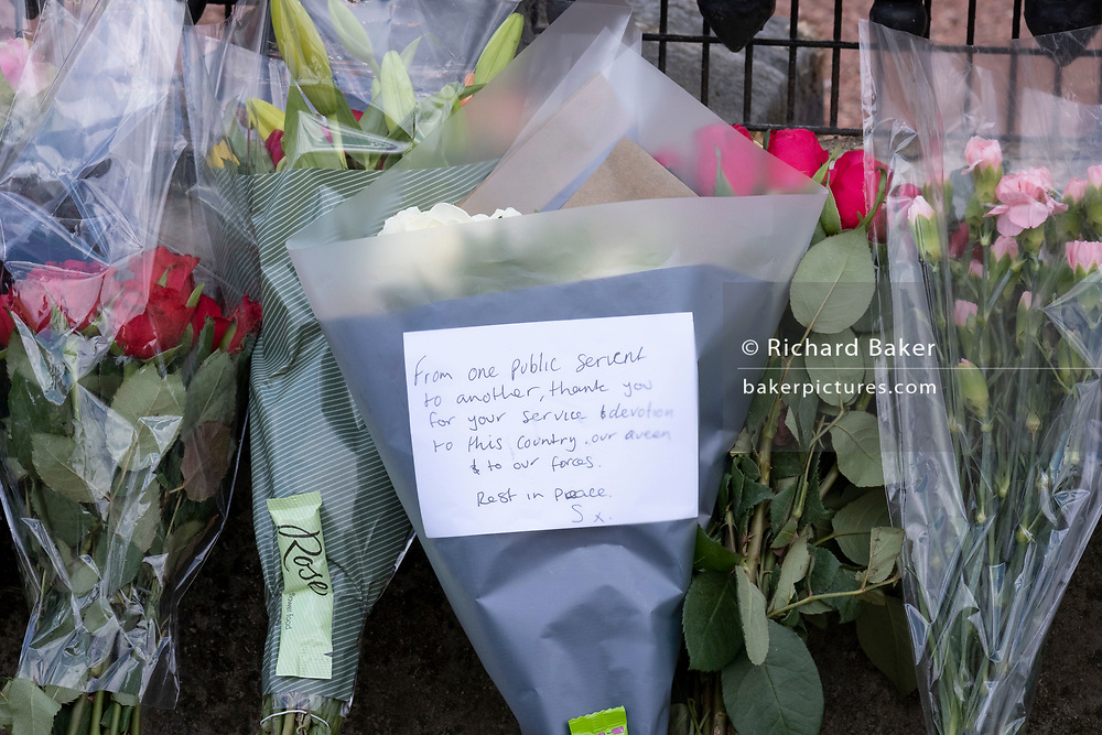Following the official announcement of the death at age 99 of Prince Phillip, the Duke of Edinburgh, consort to Queen Elizabeth II, tributes are left outside Buckingham Palace, on 9th April 2021, in London, Emgland.