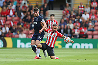 Football - 2021/ 2022 Premier League - Southampton vs. West Ham United - St Mary's Stadium - Saturday 11th August<br /> <br /> Declan Rice of West Ham United and Southampton's Adam Armstrong in action during the Premier League match at St Mary's Stadium Southampton<br /> <br /> COLORSPORT/Shaun Boggust