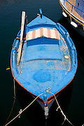 Greece, Island of Crete, Old small fishing boat in pastel blue