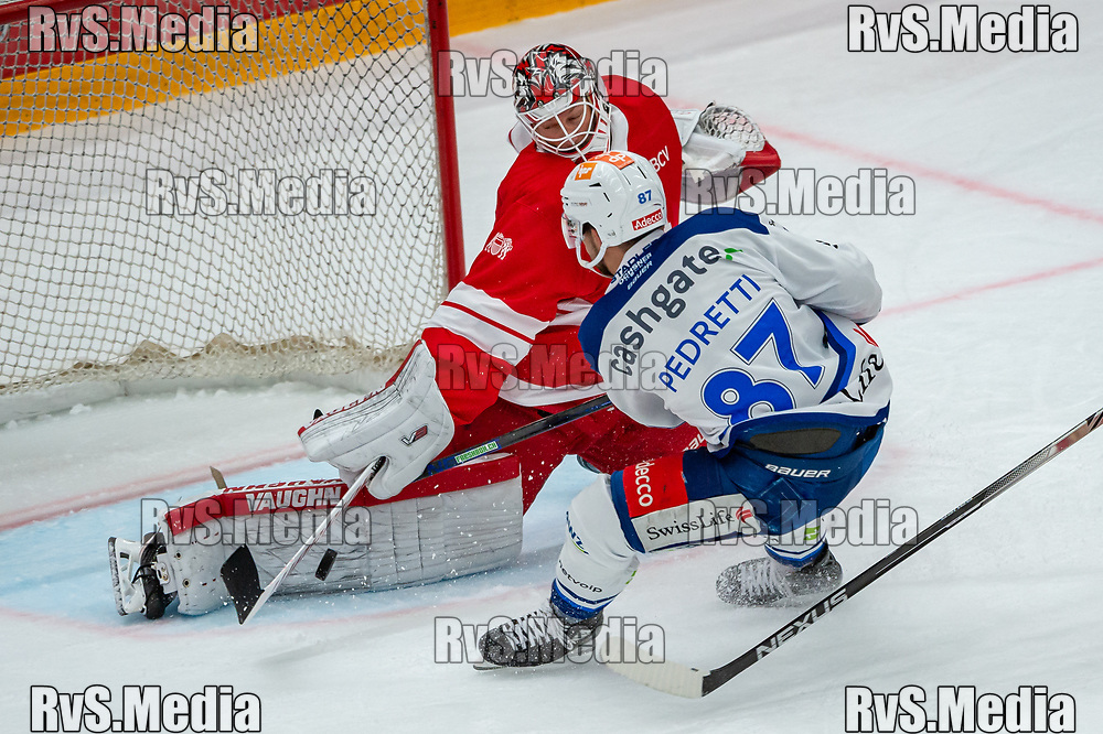 LAUSANNE, SWITZERLAND - OCTOBER 01: Marco Pedretti #87 of ZSC Lions tries to score against Goalie Tobias Stephan #51 of Lausanne HC during the Swiss National League game between Lausanne HC and ZSC Lions at Vaudoise Arena on October 1, 2021 in Lausanne, Switzerland. (Photo by Robert Hradil/RvS.Media)