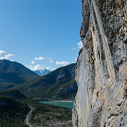 Josh Wells climbing In Us Under Us, 5.11b at Barrier in Kananaskis
