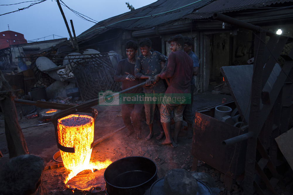 June 3, 2017 - Dhaka, Dhaka, Bangladesh - Bangladeshi workers make ship propellers at a metal workshop in a shipyard by the river Buriganga in Dhaka. There are more than 35 shipyards in Old Dhaka's Keraniganj area by the side of the Buriganga River, where ships, launches, and steamers of various sizes and shapes are built and repaired round the clock. About 15,000 workers, who work in these dockyards, earn Tk. 300_400 BDT (approx. US $4 to US $5) a day. They mostly work without goggles, risking serious injury or blindness, and most have no helmets, facemasks or safety shoes. (Credit Image: © Probal Rashid via ZUMA Wire)