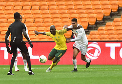 South Africa: Johannesburg: Bafana Bafana player Aubrey Modiba battle for the ball with Seychelles player Karl Hopprich during the Africa Cup Of Nations qualifiers at FNB stadium, Gauteng.<br />Picture: Itumeleng English/African News Agency (ANA)
