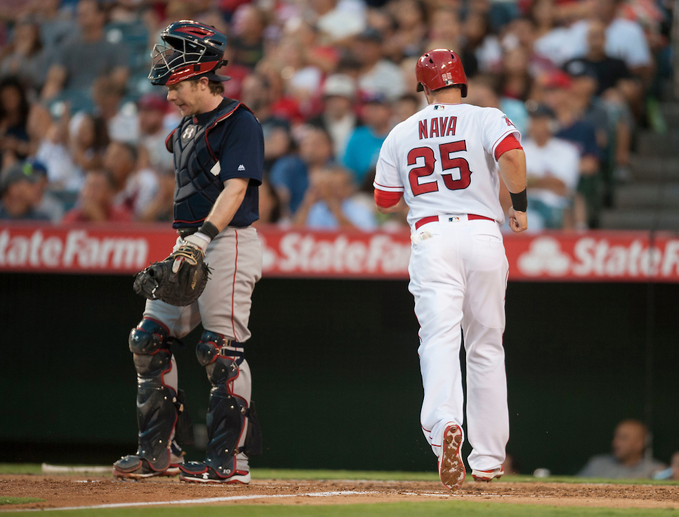 The Angels' Daniel Nava scores past Boston catcher Ryan Hanigan in the second inning at Angel Stadium on Friday.<br /> <br /> ///ADDITIONAL INFO:   <br /> <br /> angels.0730.kjs  ---  Photo by KEVIN SULLIVAN / Orange County Register  -- 7/29/16<br /> <br /> The Los Angeles Angels take on the Boston Red Sox at Angel Stadium.