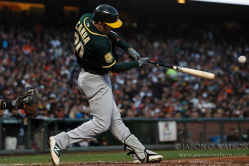 SAN FRANCISCO, CA - JULY 13: Mark Canha #20 of the Oakland Athletics at bat against the San Francisco Giants during the fourth inning at AT&T Park on July 13, 2018 in San Francisco, California. The San Francisco Giants defeated the Oakland Athletics 7-1. (Photo by Jason O. Watson/Getty Images) *** Local Caption *** Mark Canha