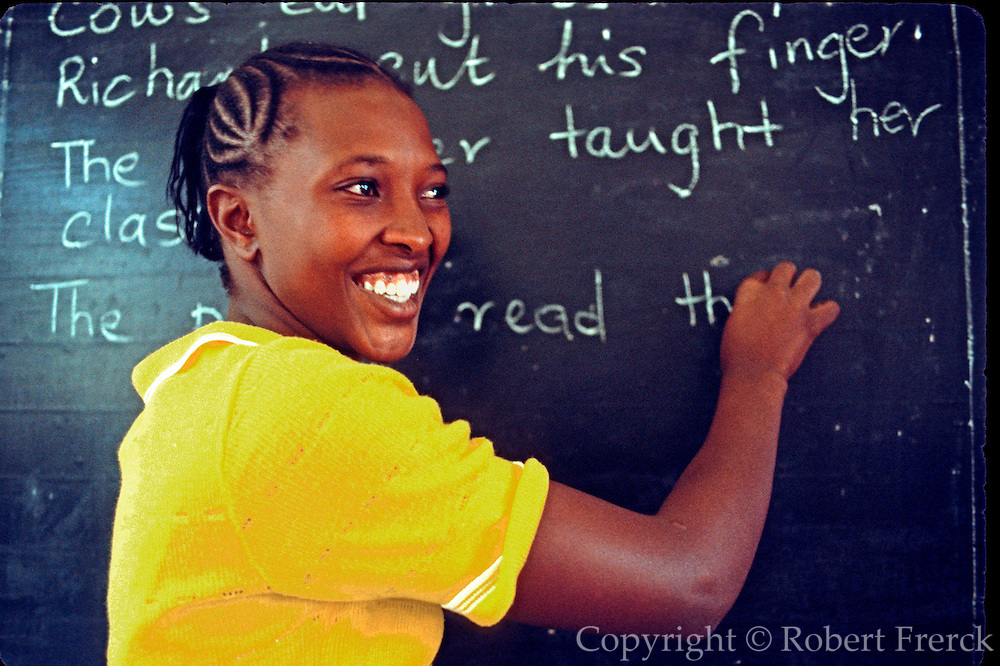 KENYA, EDUCATION NAIROBI; a primary school teacher at the blackboard in her classroom