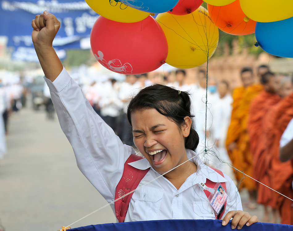 Nith Nitikar, an 18-year old student, shouts as she walks with Buddhist monks and nuns to lead a march commemorating World AIDS Day in Battambang, Cambodia. Among sponsors of the march was the Salvation Centre Cambodia, an organization that works with Buddhist monks and other activists to foster support for people living with HIV and AIDS as well as public education and advocacy throughout the country.