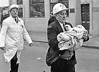 An ambulanceman carries an injured child from the scene of a Provisional IRA car bomb explosion in Bradbury Place, Belfast, N Ireland. 197201210021d.<br /> <br /> Copyright Image from Victor Patterson, Belfast, UK<br /> <br /> t: +44 28 9066 1296 (from Rep of Ireland 048 9066 1296)<br /> m: +44 7802 353836<br /> <br /> victorpattersonbelfast@gmail.com<br /> victorpatterson@me.com<br /> <br /> www.victorpatterson.com<br /> <br /> Please see my Terms and Conditions of Use at https://www.victorpatterson.com/page2<br /> It is IMPORTANT that you familiarise yourself with them.<br /> <br /> Images used on the Internet incur an additional cost and must be visibly watermarked i.e. © Victor Patterson within the body of the image and copyright metadata must not be deleted. Images used on the Internet have a size restriction of 4kbs and are chargeable at rates available at victorpatterson.com.<br /> <br /> This image is available only for the use of the download recipient i.e. television station, newspaper, magazine, book publisher, etc, and must not be passed on to any third party. It is also downloaded on condition that each and every usage is notified within 7 days to victorpatterson@me.com<br /> <br /> The right of Victor Patterson (or the named photographer) to be identified as the author is asserted in accordance with The Copyright Designs And Patents Act (1988). All moral rights are asserted.