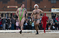 © Licensed to London News Pictures. 26/12/2011..Redcar Beach, Redcar, England..Participants once again took to the cold waters of the North sea in the annual Boxing Day dip at Redcar in Cleveland...Hundreds of people ran into the chilly waters as they do each year many raising money for various charities...Photo credit : Ian Forsyth/LNP