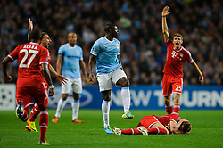 Bayern Midfielder Toni Kroos (GER) lays on the ground after a collision in the compete in the air with Man City Defender Micah Richards (ENG) during the first half of the match - Photo mandatory by-line: Rogan Thomson/JMP - Tel: Mobile: 07966 386802 - 02/10/2013 - SPORT - FOOTBALL - Etihad Stadium, Manchester - Manchester City v Bayern Munich - UEFA Champions League Group D.