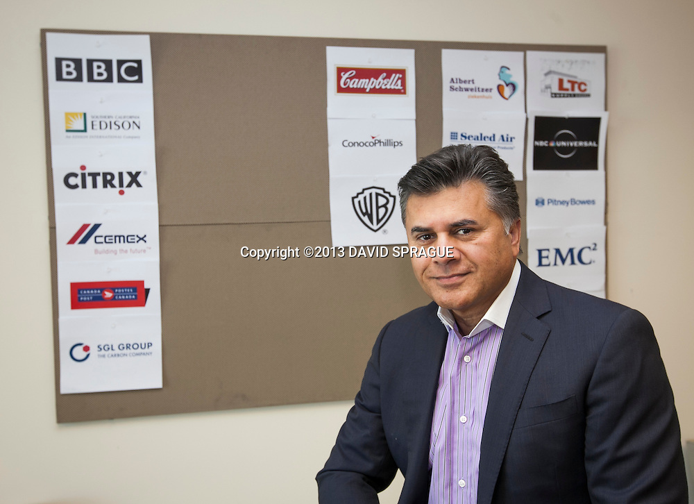 Najeeb Ghauri, CEO of NetSol poses in front of a board with some of the his customers logos. He founded his company 15 years ago with his two brothers.  Shot Feb. 26,  2013 Photo by David Sprague ©2013