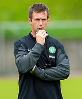 10/07/14      <br /> CELTIC TRAINING<br /> AUSTRIA<br /> Celtic manager Ronny Deila casts an eye over training