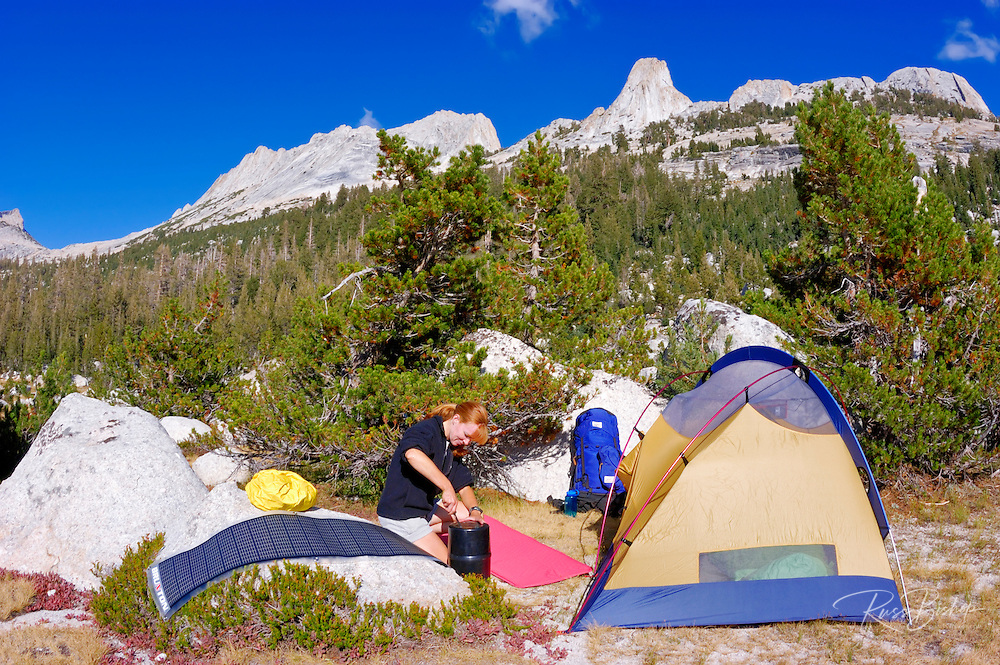 Backpacker setting up camp under Matthes Crest, Yosemite National Park, California
