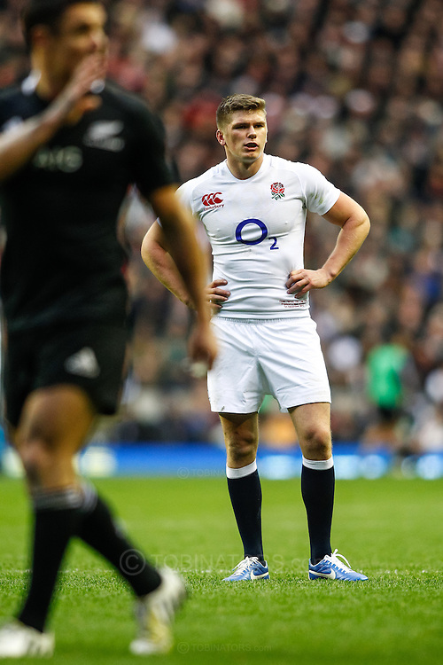 Picture by Andrew Tobin/SLIK images +44 7710 761829. 2nd December 2012. Owen Farrell of England looks on with Dan Carter in the foreground during the QBE Internationals match between England and the New Zealand All Blacks at Twickenham Stadium, London, England. England won the game 38-21.