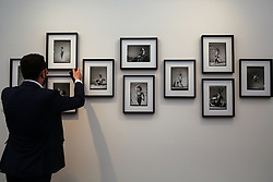 © Licensed to London News Pictures. 15/05/2019. London, UK. An exhibitor puts finishing touches to Gian Paolo Barbieri photographs at the preview of Photo London 2019 at Somerset House, the largest photography event. The annual event in its fifth year, showcases the work of over 100 of the world's leading galleries from 21 different countries. The fair opens at Somerset House on 196 May and runs until 19 May 2019.  Photo credit: Dinendra Haria/LNP