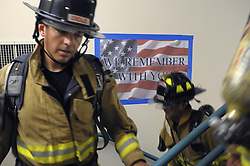 Sept. 11, 2012 - Albuquerque, NM, U.S. - asec.  Twenty three firefighters honored the 343 firefighters that died responding to the terrorist attacks on the Twin Towers eleven years ago by climbing the twenty two flights of stairs at the Bank of Albuquerque Building five times, the same height of the Twin Towers, photographed Tuesday Sept. 11, 2012. (Credit Image: © Pat Vasquez-Cunningham/Albuquerque Journal/ZUMAPRESS.com)