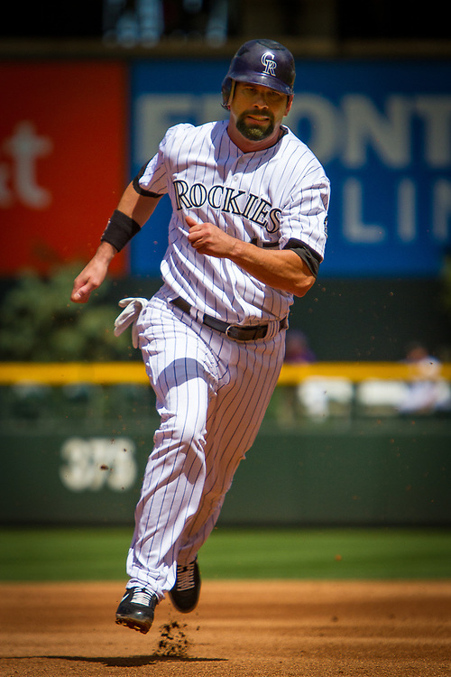 Colorado Rockies first baseman TODD HELTON rounds third during a 10-5 win over the Los Angeles Dodgers at Coors Field.