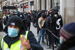 © Licensed to London News Pictures.  12/04/2021. Lonond, UK. Shoppers stand in the line to get into Nike shop at Oxford Street, central London as the government takes the next step on its lockdown-lifting road map and non-essential shops reopen today. Photo credit: Marcin Nowak/LNP