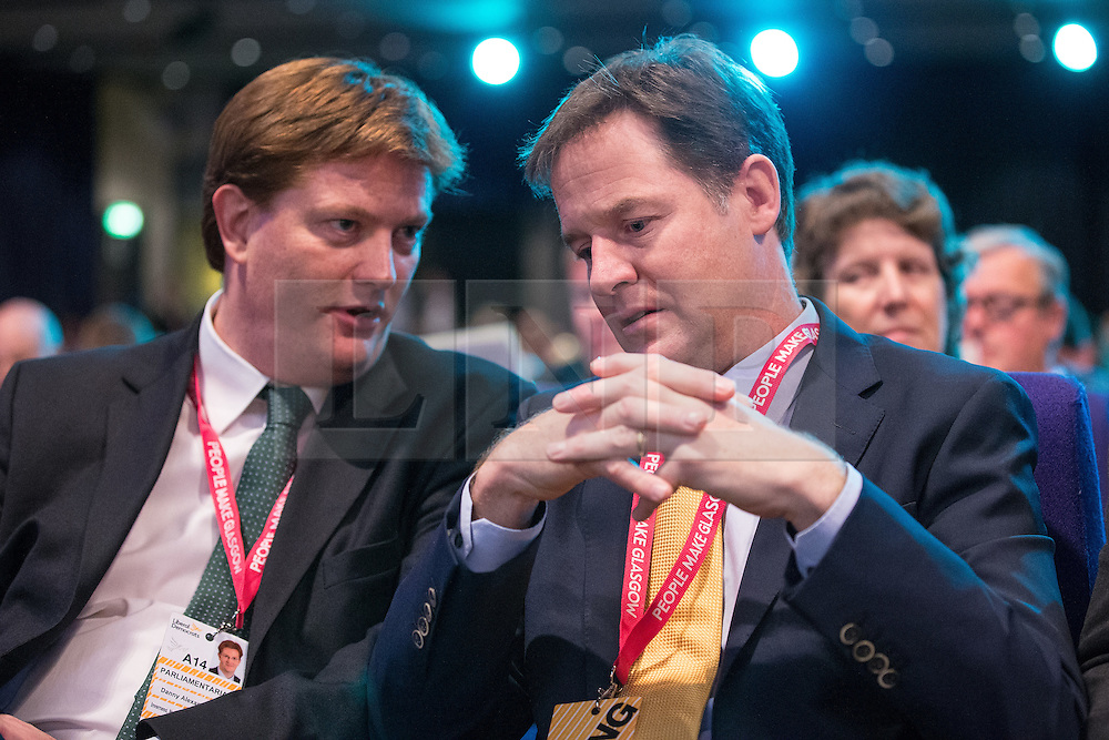 © Licensed to London News Pictures . 07/10/2014 . Glasgow , UK . Danny Alexander and Nick Clegg confer at the conference . The Liberal Democrat Party Conference 2014 at the Scottish Exhibition and Conference Centre in Glasgow . Photo credit : Joel Goodman/LNP
