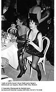 Lady at Swifty Lazar's Oscar Night party. Spago's. Hollywood. Los Angeles. March 1990. Film. 90226/4<br />© Copyright Photograph by Dafydd Jones<br />66 Stockwell Park Rd. London SW9 0DA<br />Tel 0171 733 0108