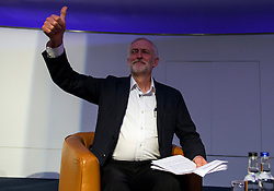 © Licensed to London News Pictures. 14/05/2016. London, UK. Leader of the Labour Party, JEREMY CORBYN arrives on stage to give a keynote address to Progress annual conference at TUC Congress Centre in London. Photo credit: Ben Cawthra/LNP