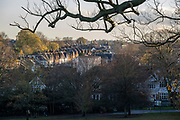 Terraced houses and Victorian-era flats are seen from Herne Hill's Brockwell Park, on 19th November 2020, in Lambeth, London, England.