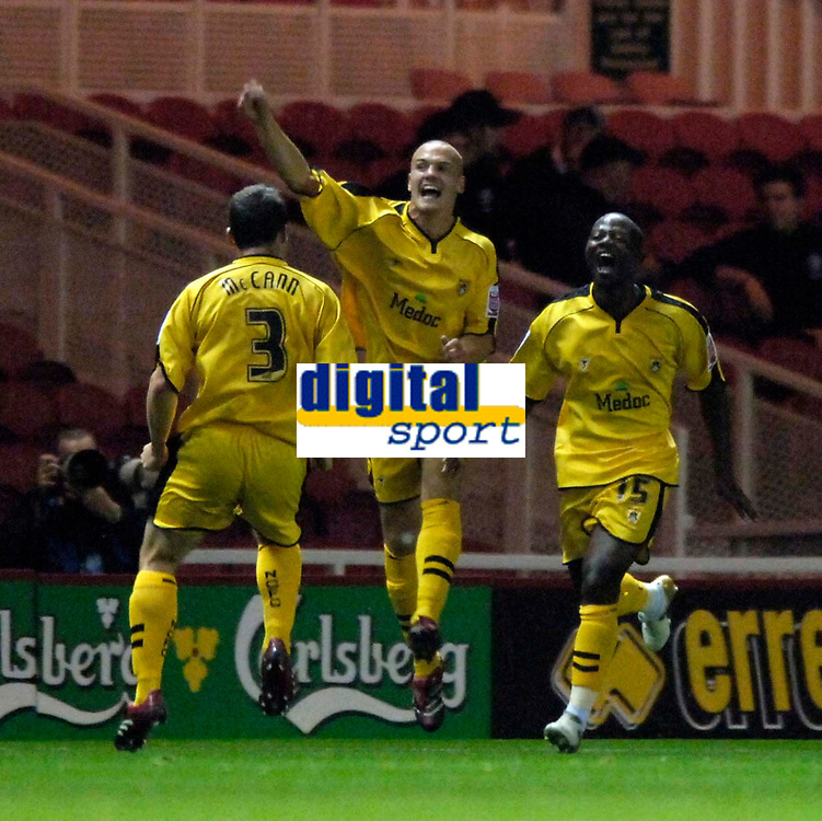 Photo: Jed Wee.<br /> Middlesbrough v Notts County. Carling Cup. 20/09/2006.<br /> <br /> Notts County's Matthew Somner (C) celebrates with goalscorer Tcham N'Toya-Zoa (R) after they take a shock lead.