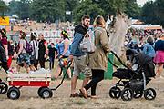 Henham Park, Suffolk, 18 July 2019. Kids in all sorts of trollies - The 2019 Latitude Festival.