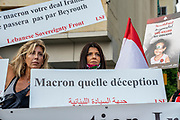 Protesters hold up signs and argue with military officials outside the Residence Des Pins before Emmanuel Macron delivers press conference on Tuesday, 01 Sep 2020. (VXP Pictures/ Matt Kynaston)