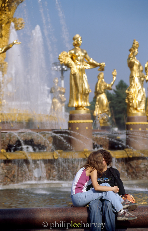 Teenage couple kissing at the Fountain of Friendship, Moscow, Russia